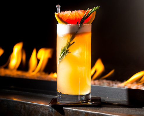 Rosemary grapefruit cocktail on a fireplace